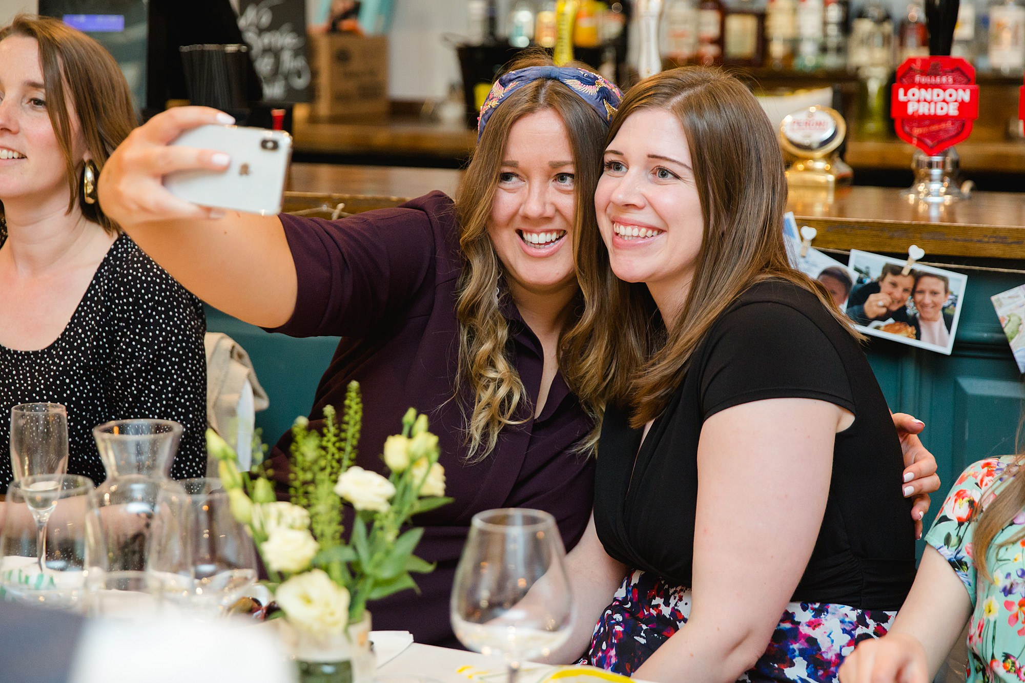 guests take a selfie at turks head pub wedding