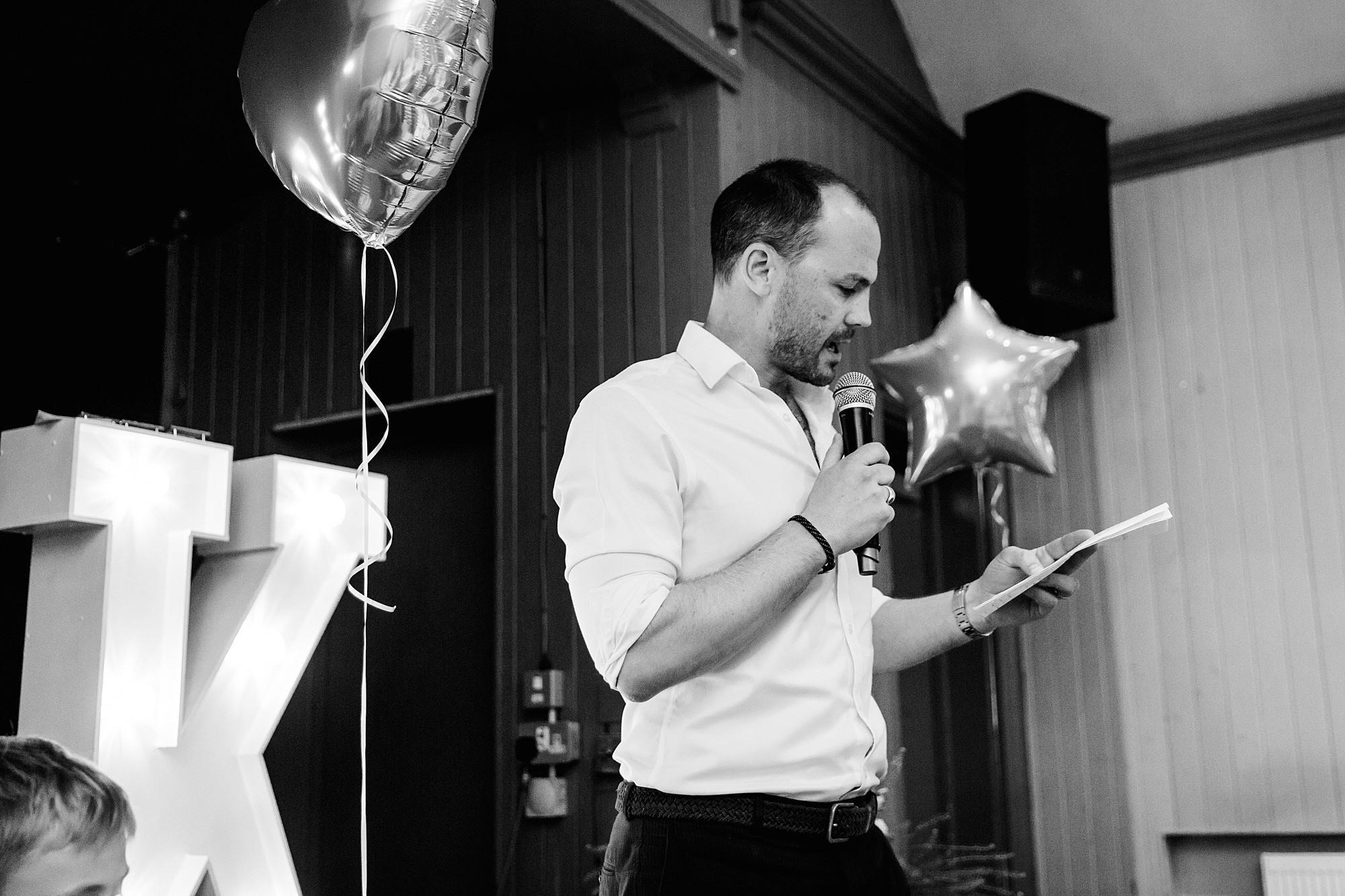 guest gives a speech at twickenham wedding