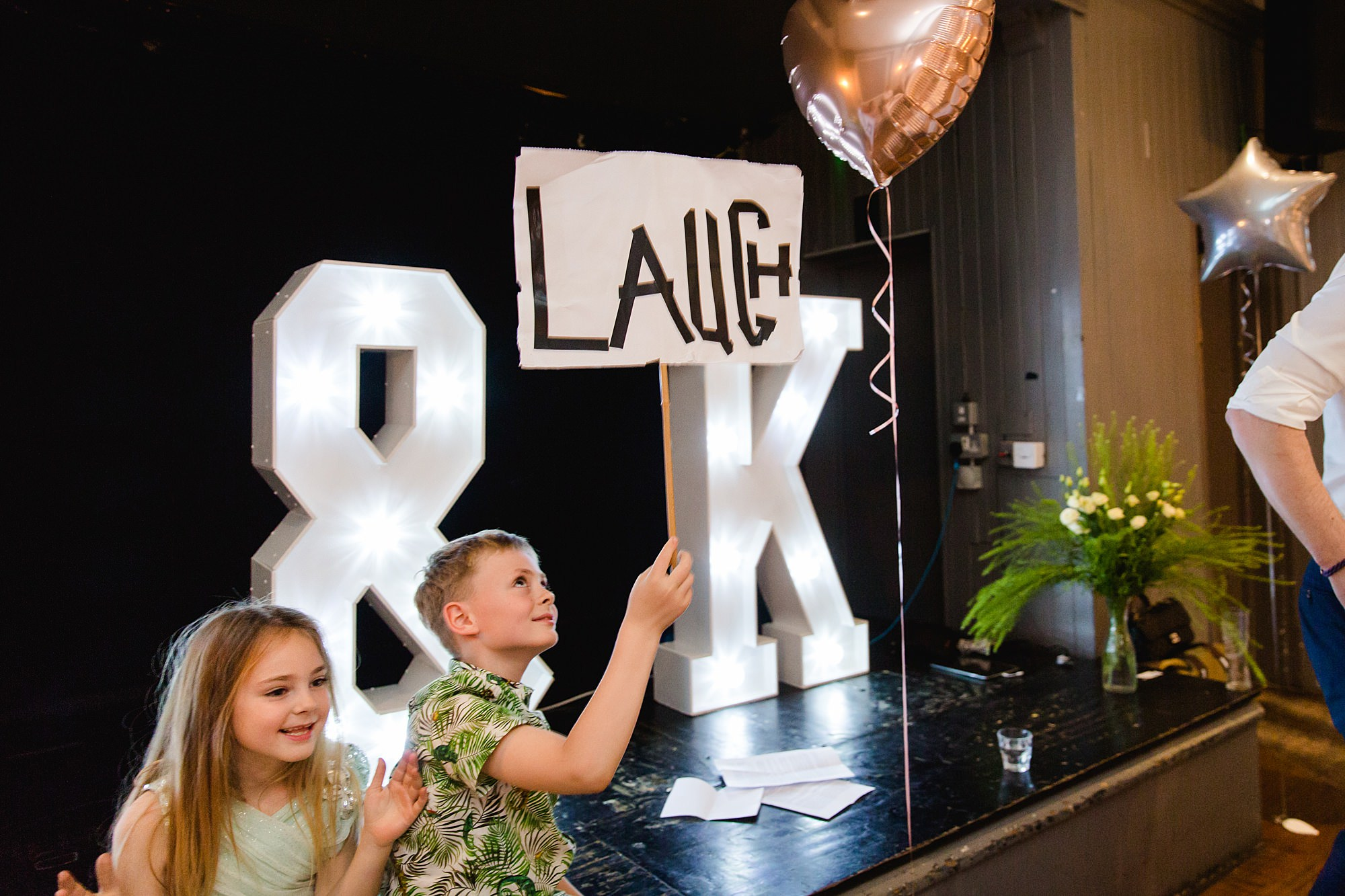 "fun ""laugh"" sign held up during speeches at turks head pub wedding"