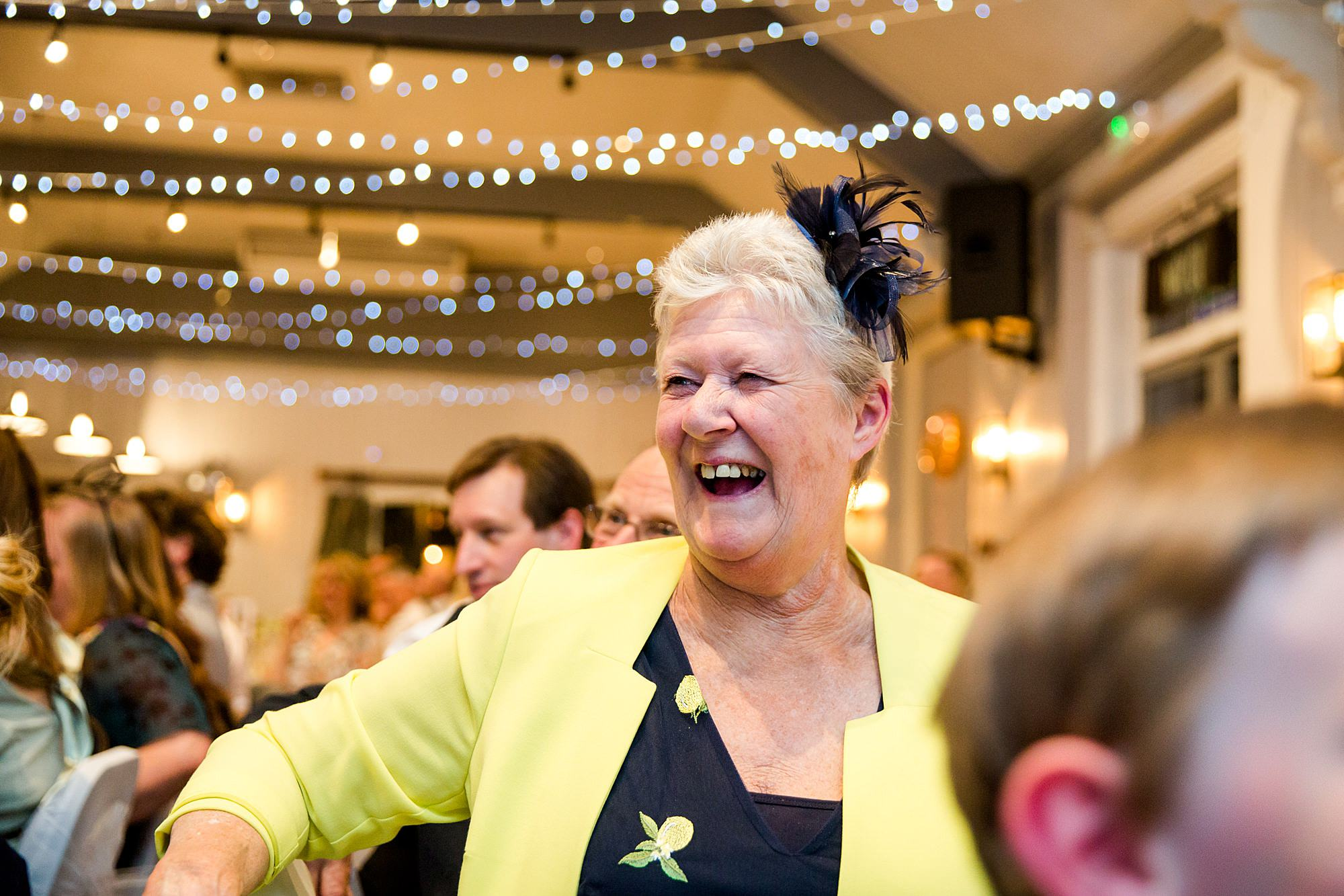 Twickenham wedding photography guest laughing at speeches