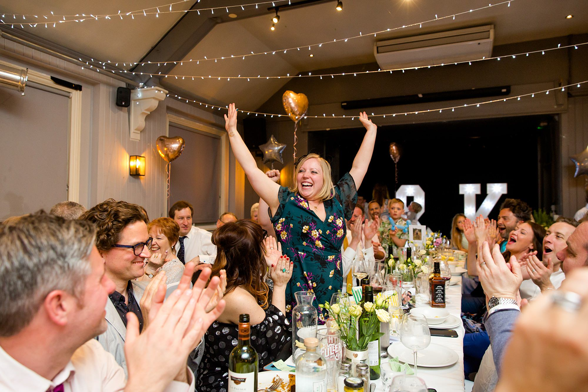 guest cheers as they win a prize at turks head pub wedding