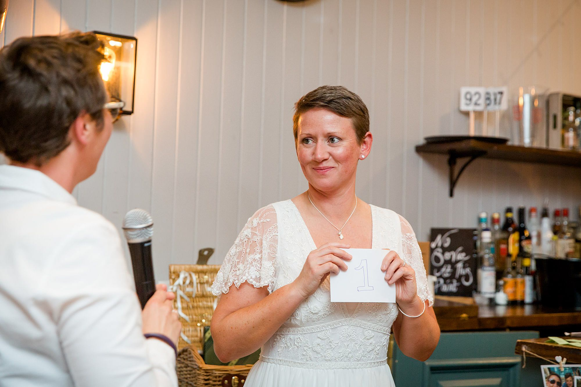 bride announces winner of bake off raffle at twickenham pub wedding
