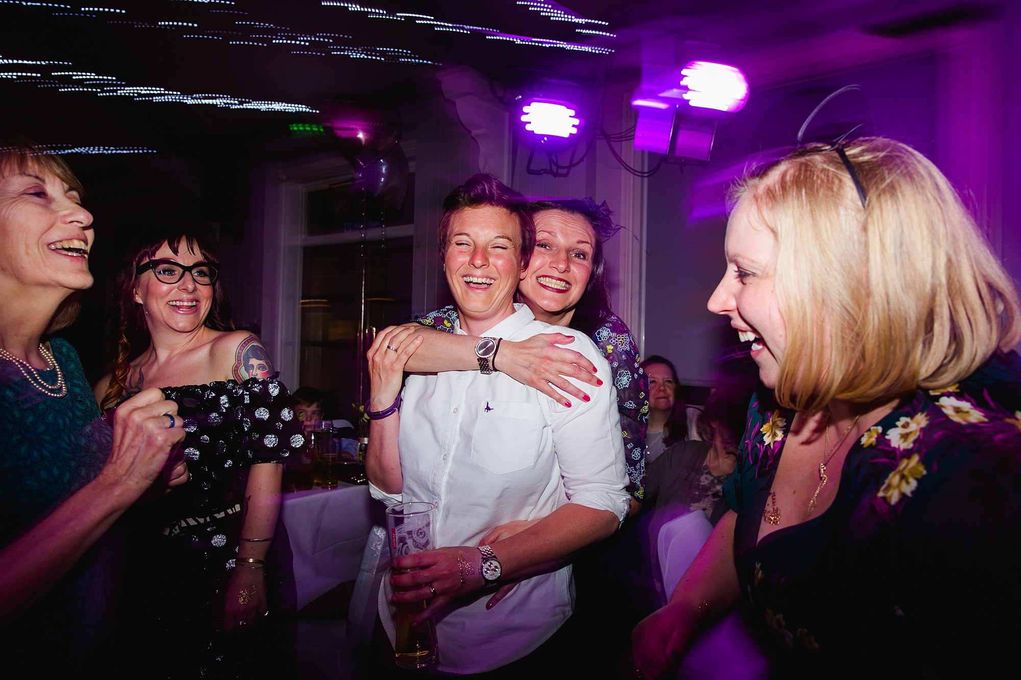 bride and friends on the dance floor at london pub wedding
