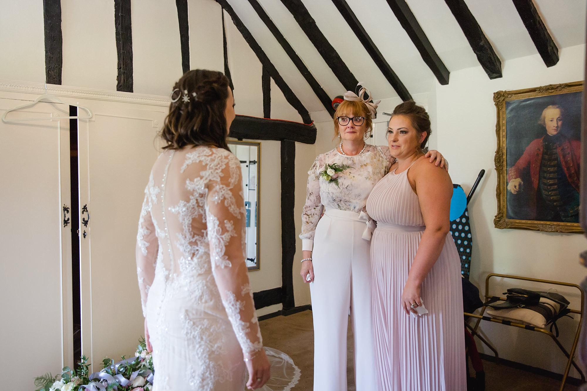 bride talks to mum and bridesmaids ahead of humanist wedding old greens barn