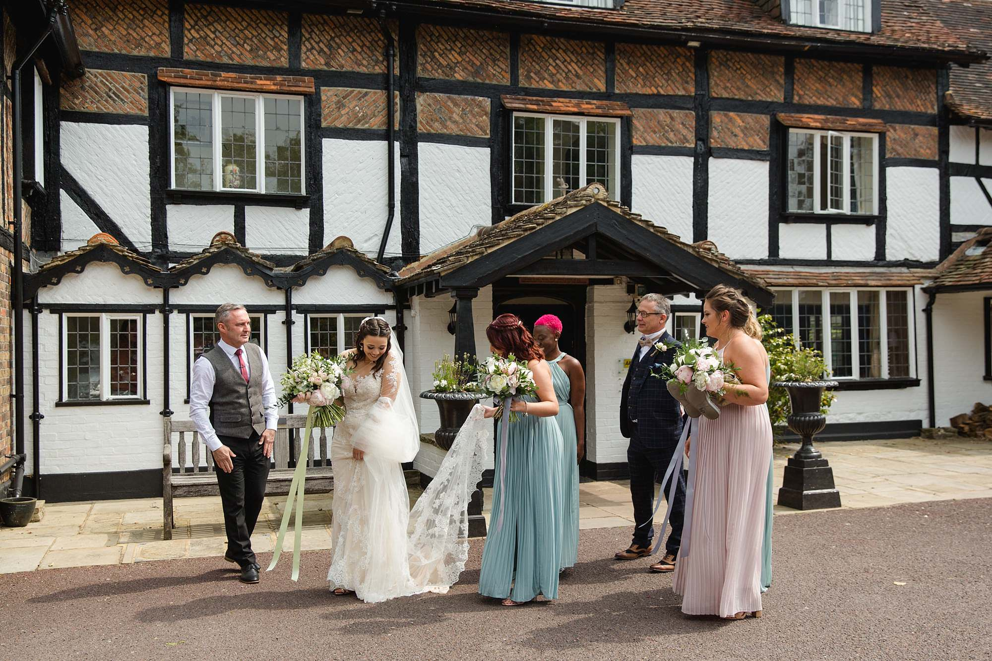 bride and wedding party ahead of humanist wedding old greens barn