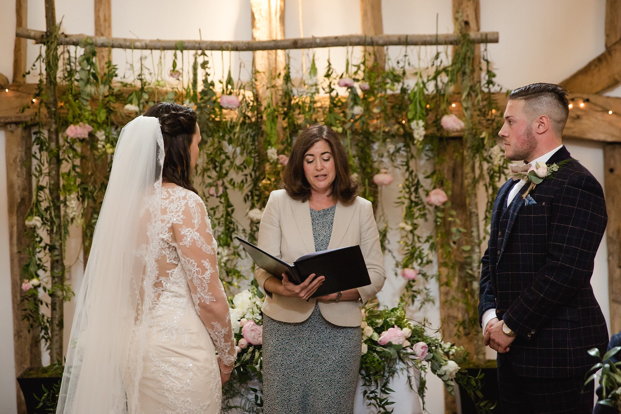 humanist celebrant conducting ceremony at hold greens barn
