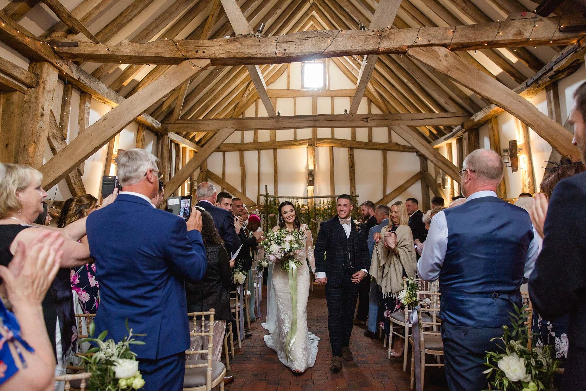 humanist wedding old greens barn bride and groom walking down aisle