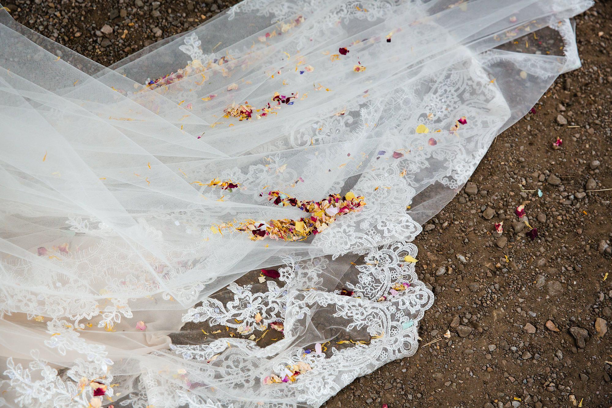 confetti on train of bride's dress
