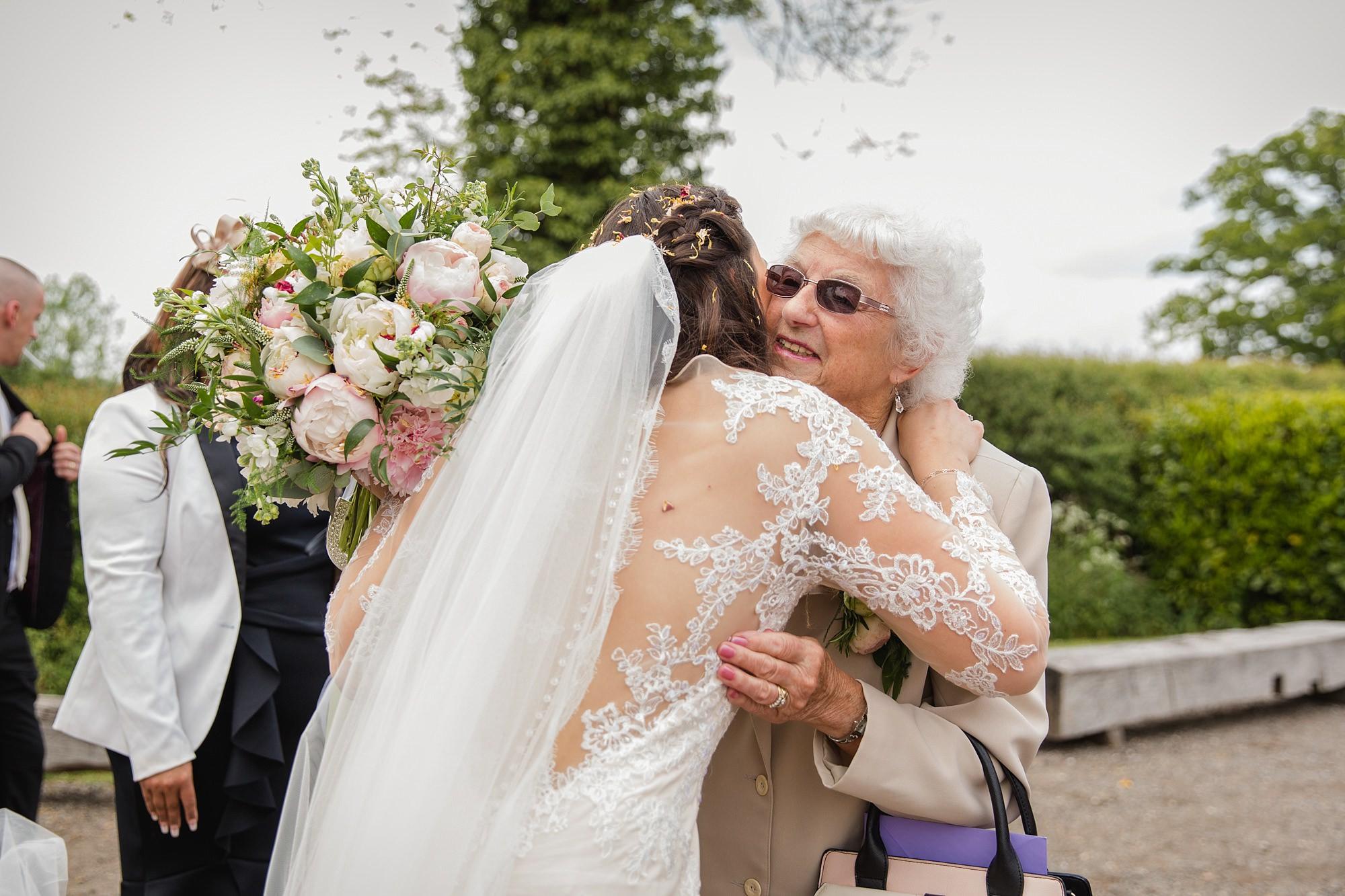 humanist wedding old greens barn bride greeting grandmother