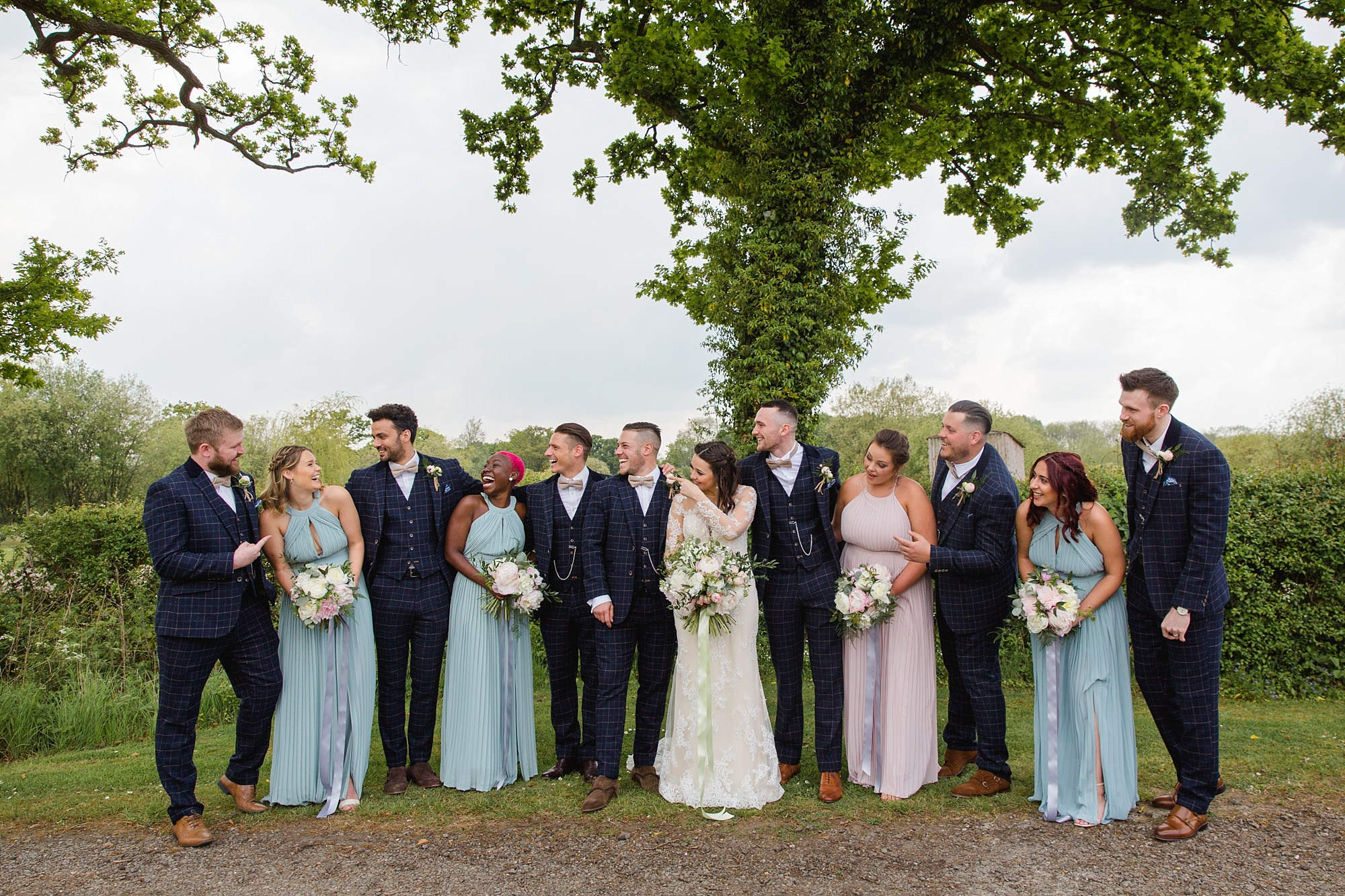 humanist wedding old greens barn wedding party laugh together