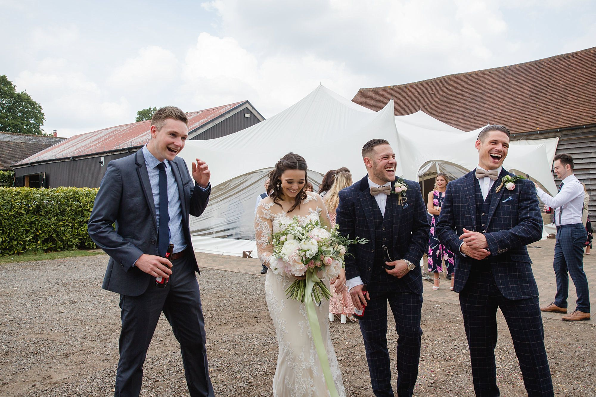 bride and groom laughing together at old greens barn wedding