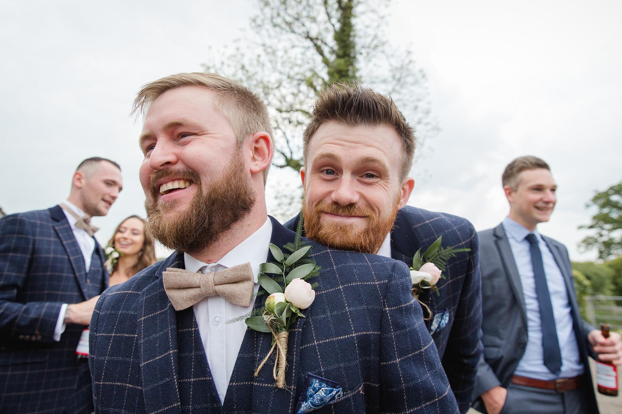 funny portrait of groomsmen at humanist wedding old greens barn