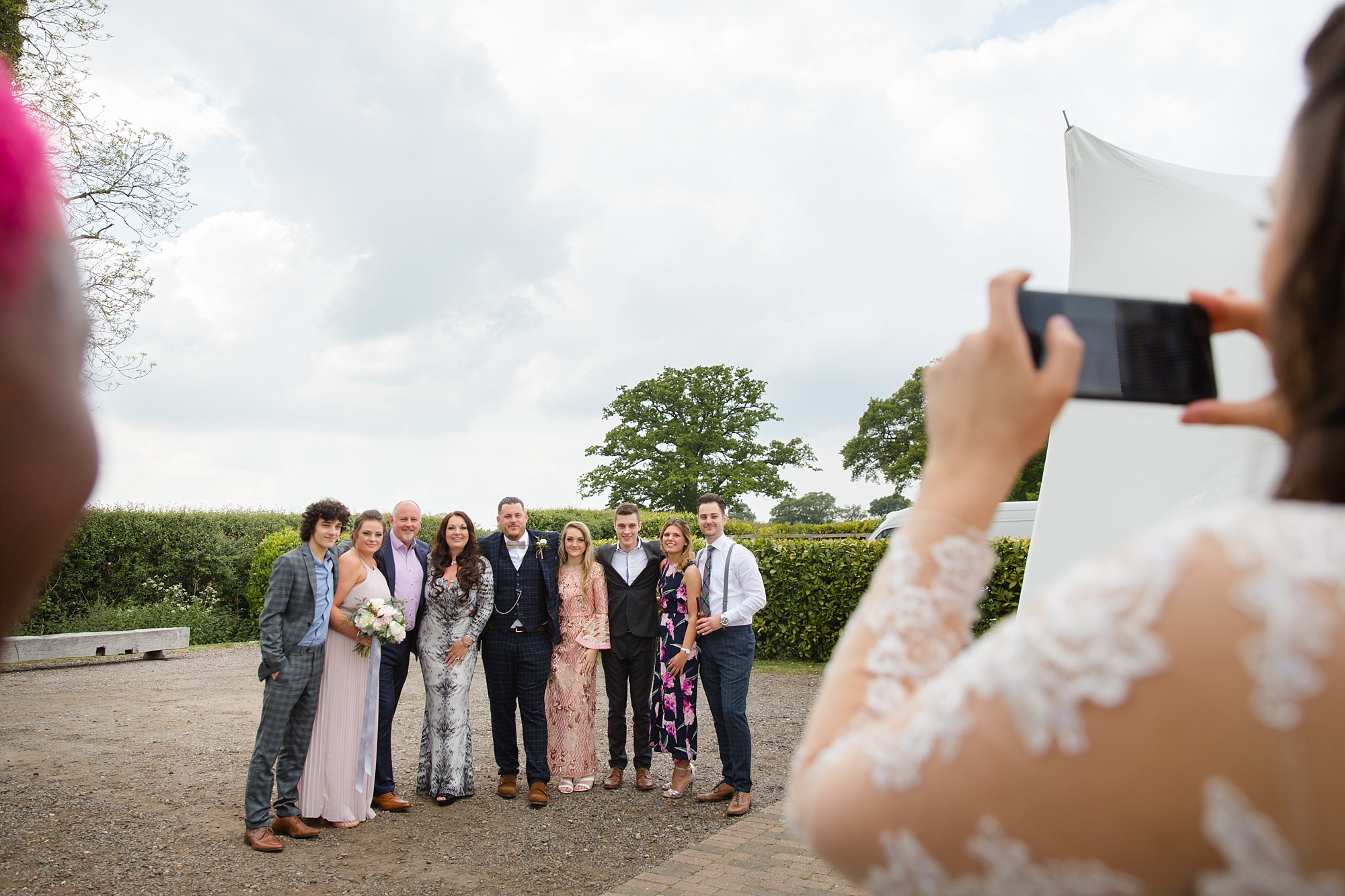humanist wedding old greens barn bride taking a picture of guests
