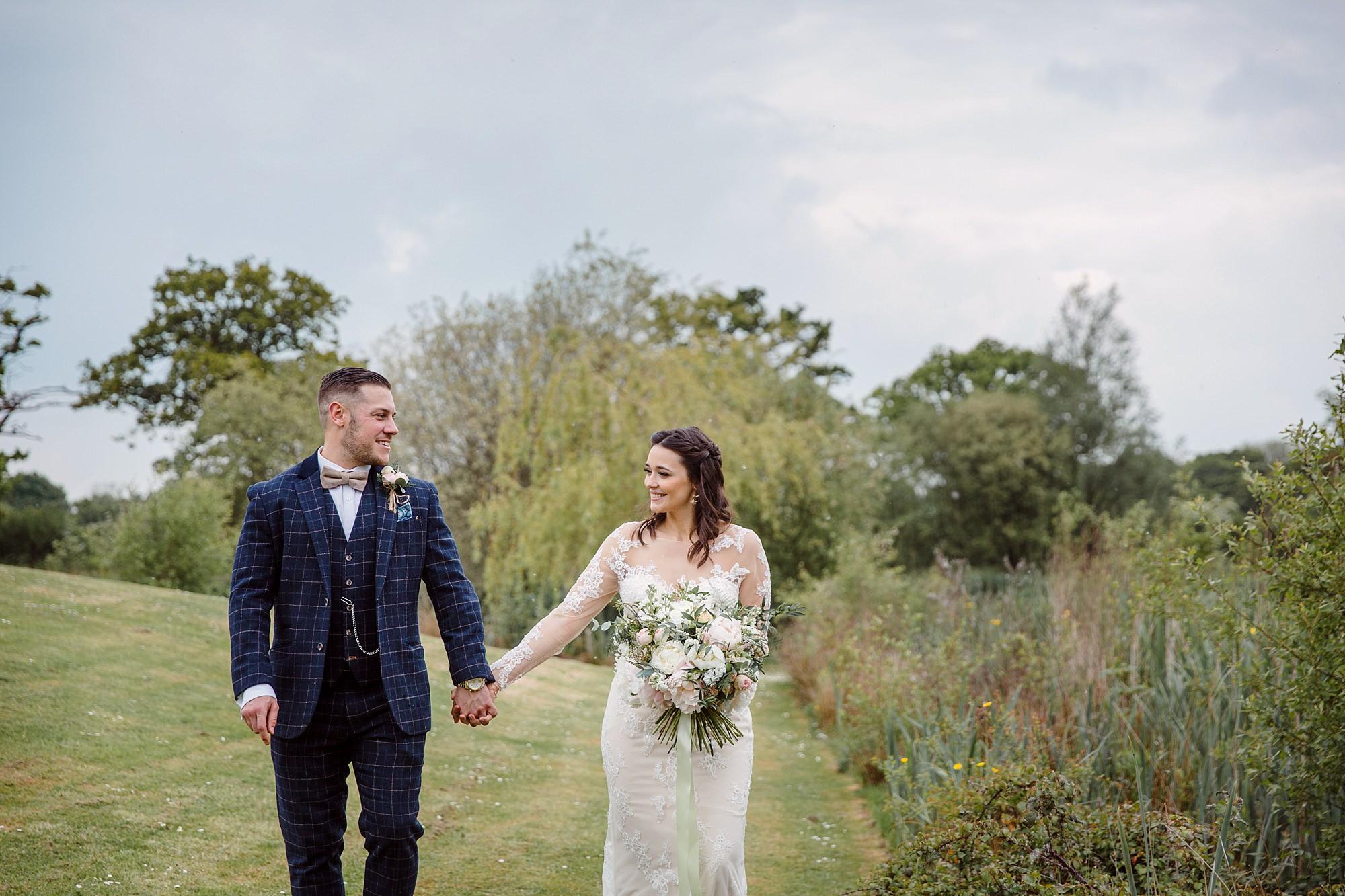 humanist wedding old greens barn bride and groom walking together