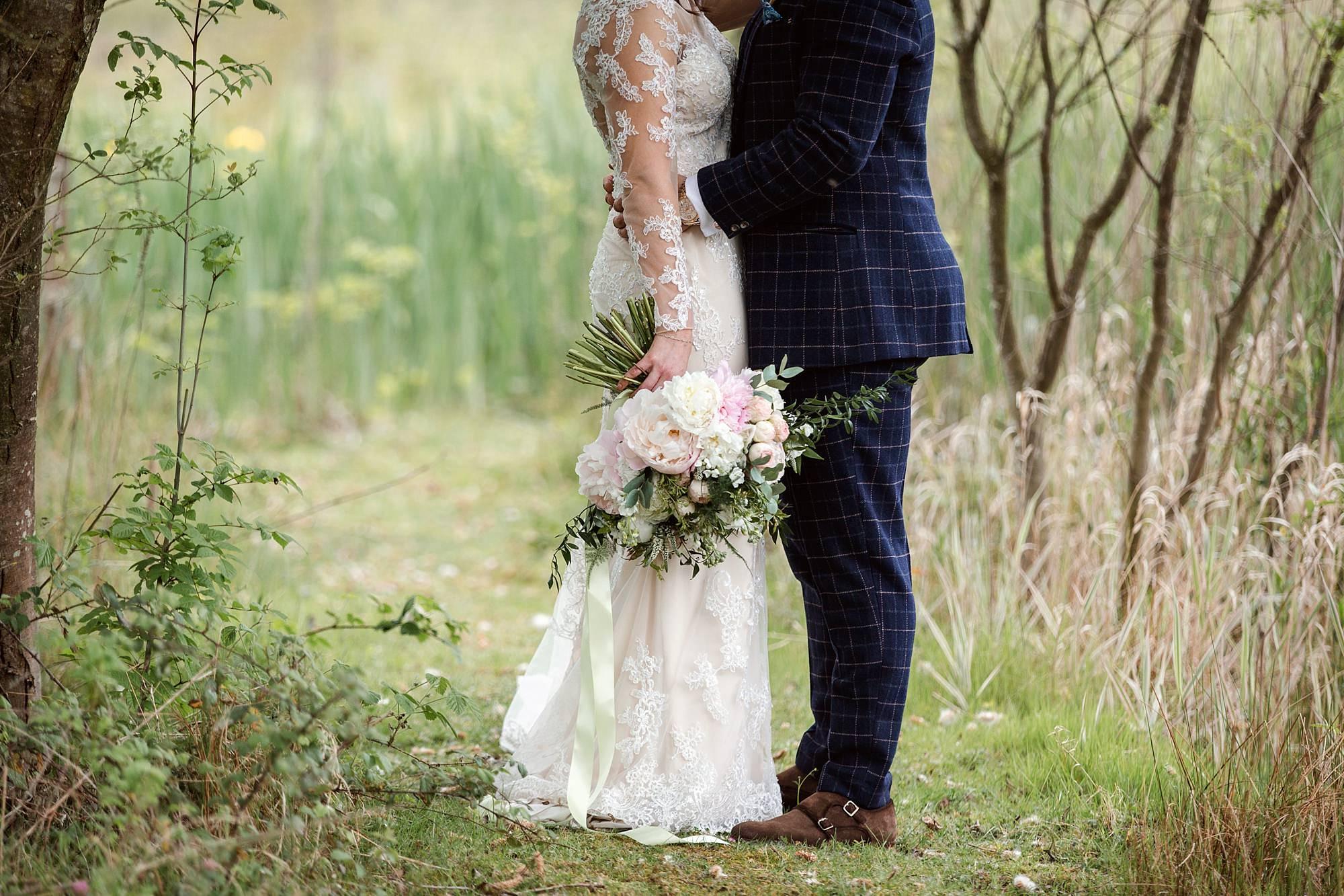 humanist wedding old greens barn bride and groom's legs