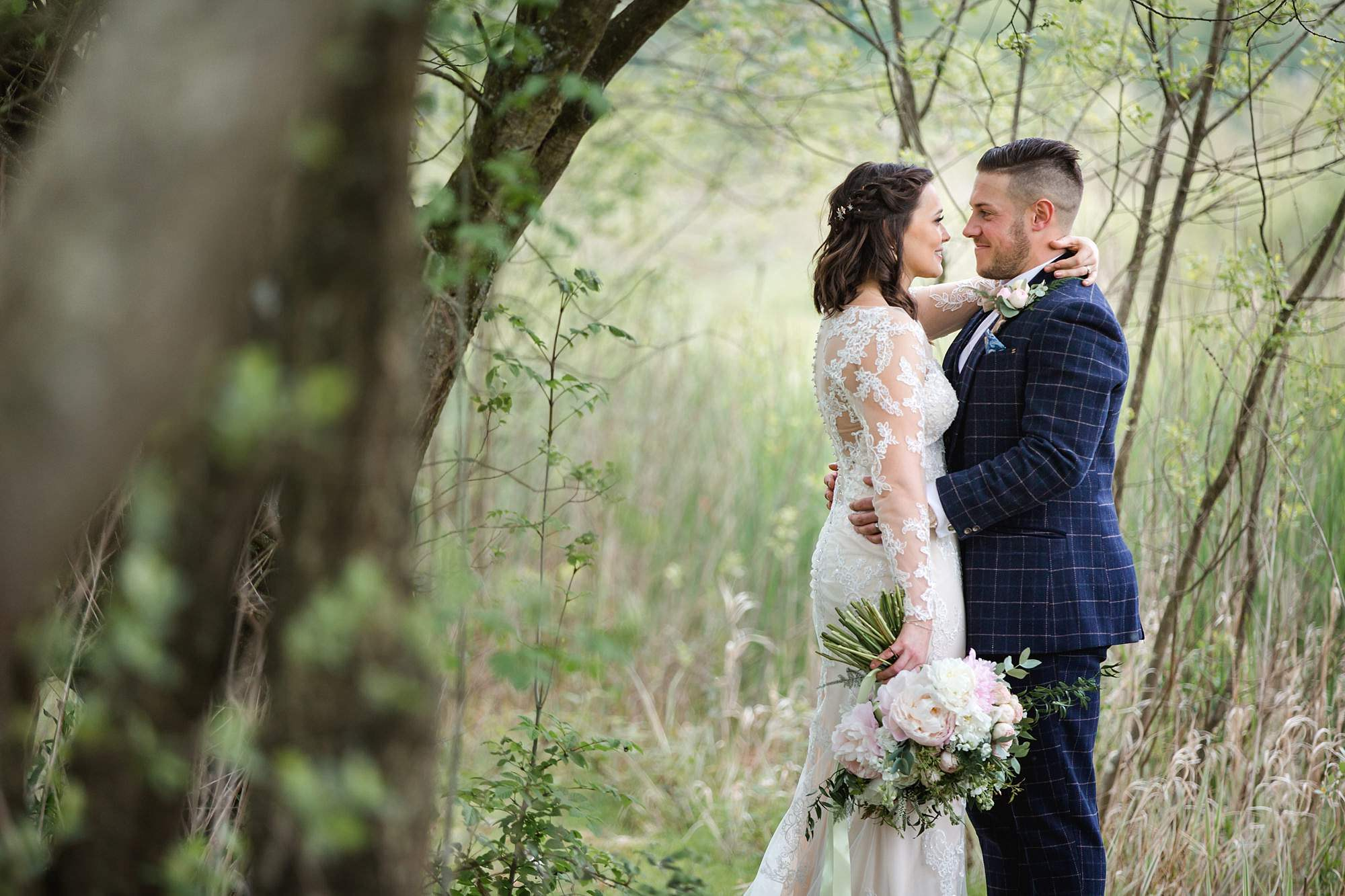 humanist wedding old greens barn bride and groom together under trees