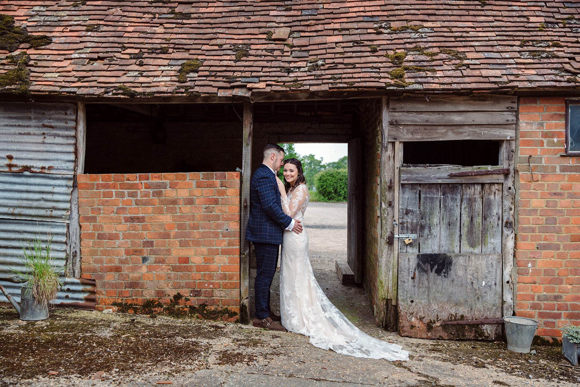 humanist wedding old greens barn bride and groom by old barn
