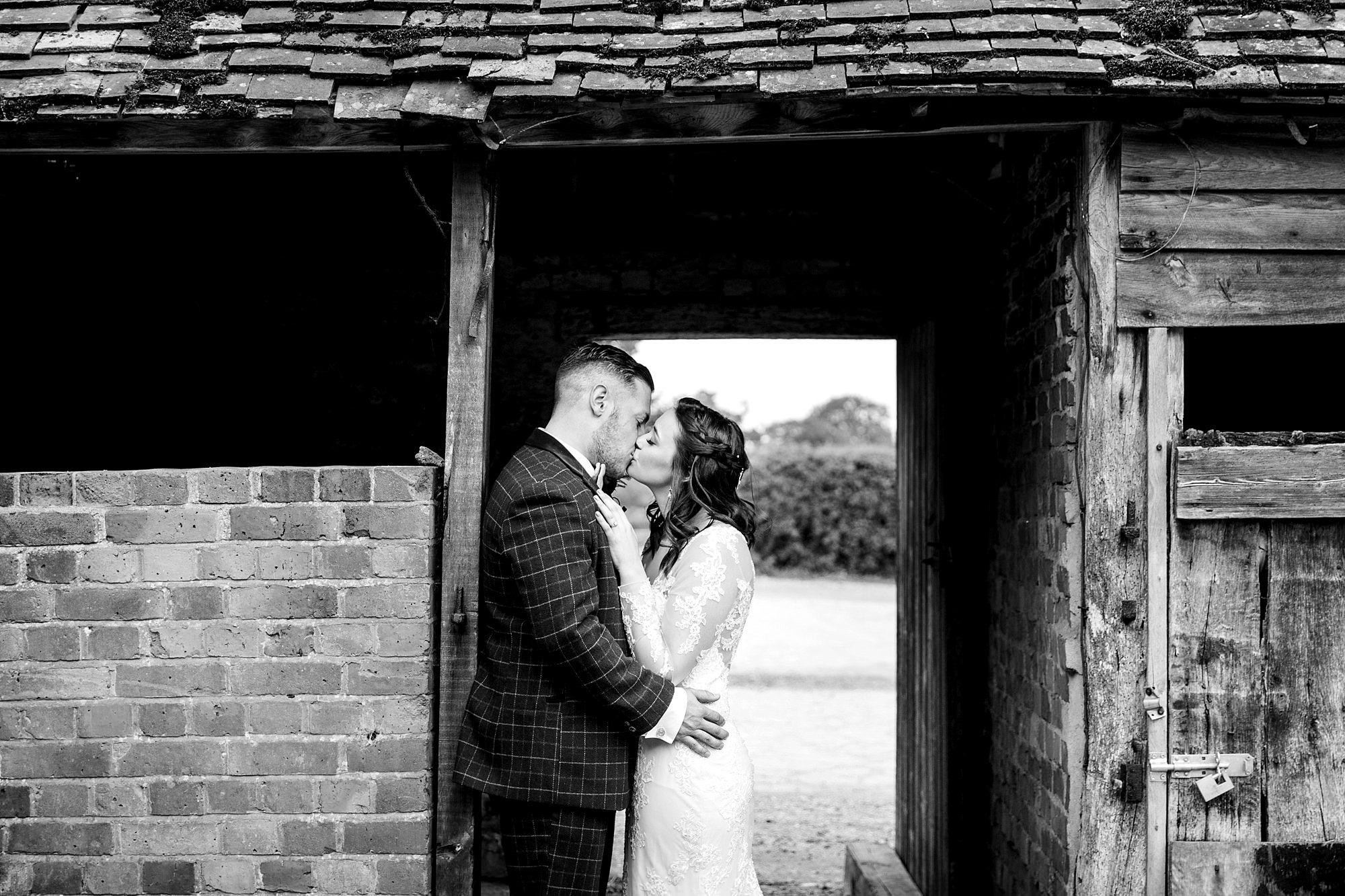 humanist wedding old greens barn bride and groom kiss in barn