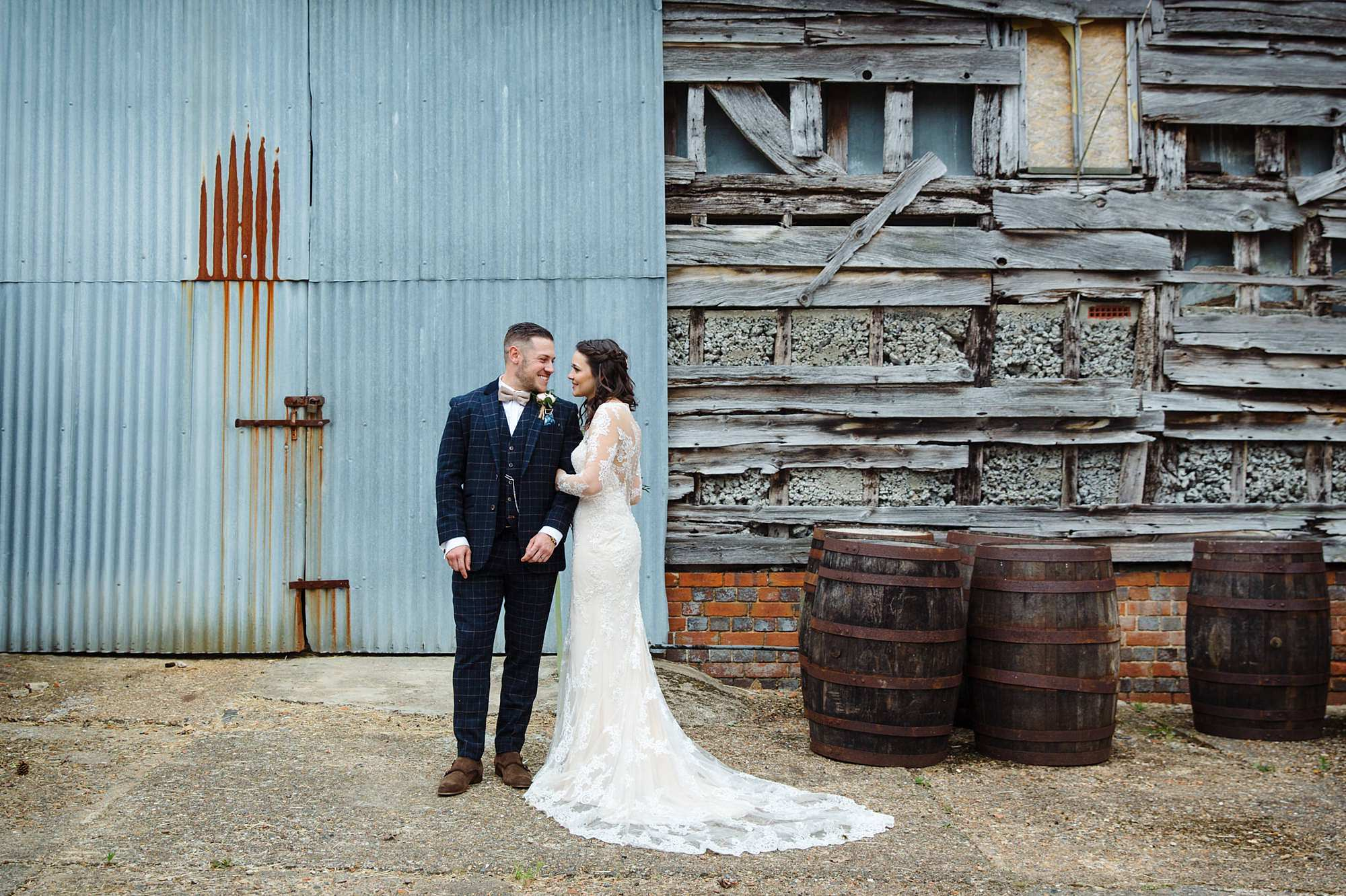 humanist wedding old greens barn bride and groom in front of rustic barn