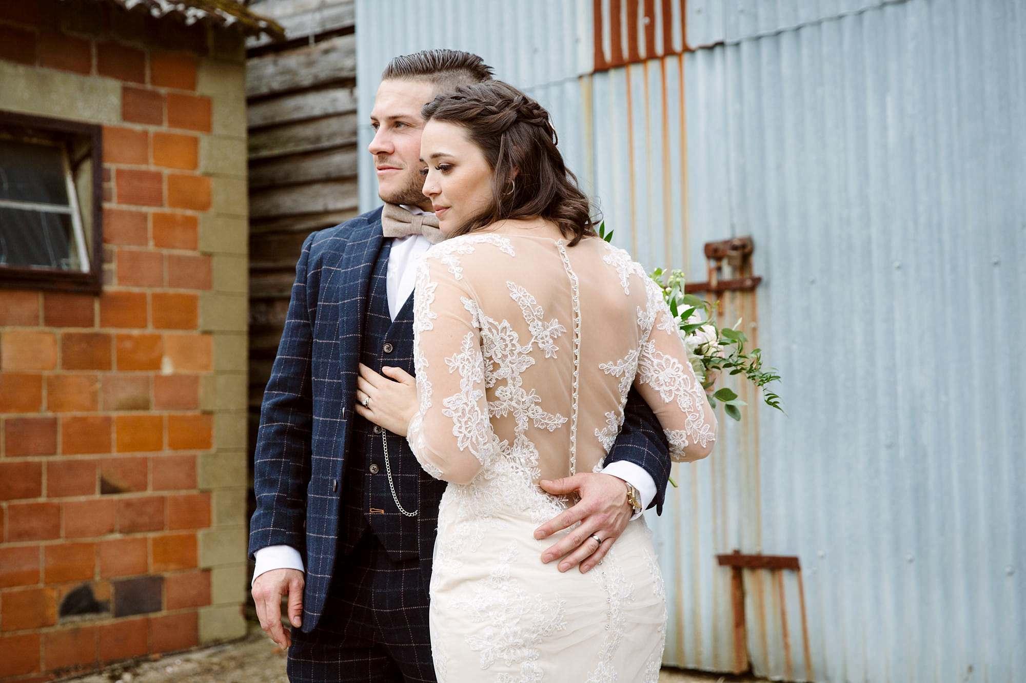 humanist wedding old greens barn groom hugs bride
