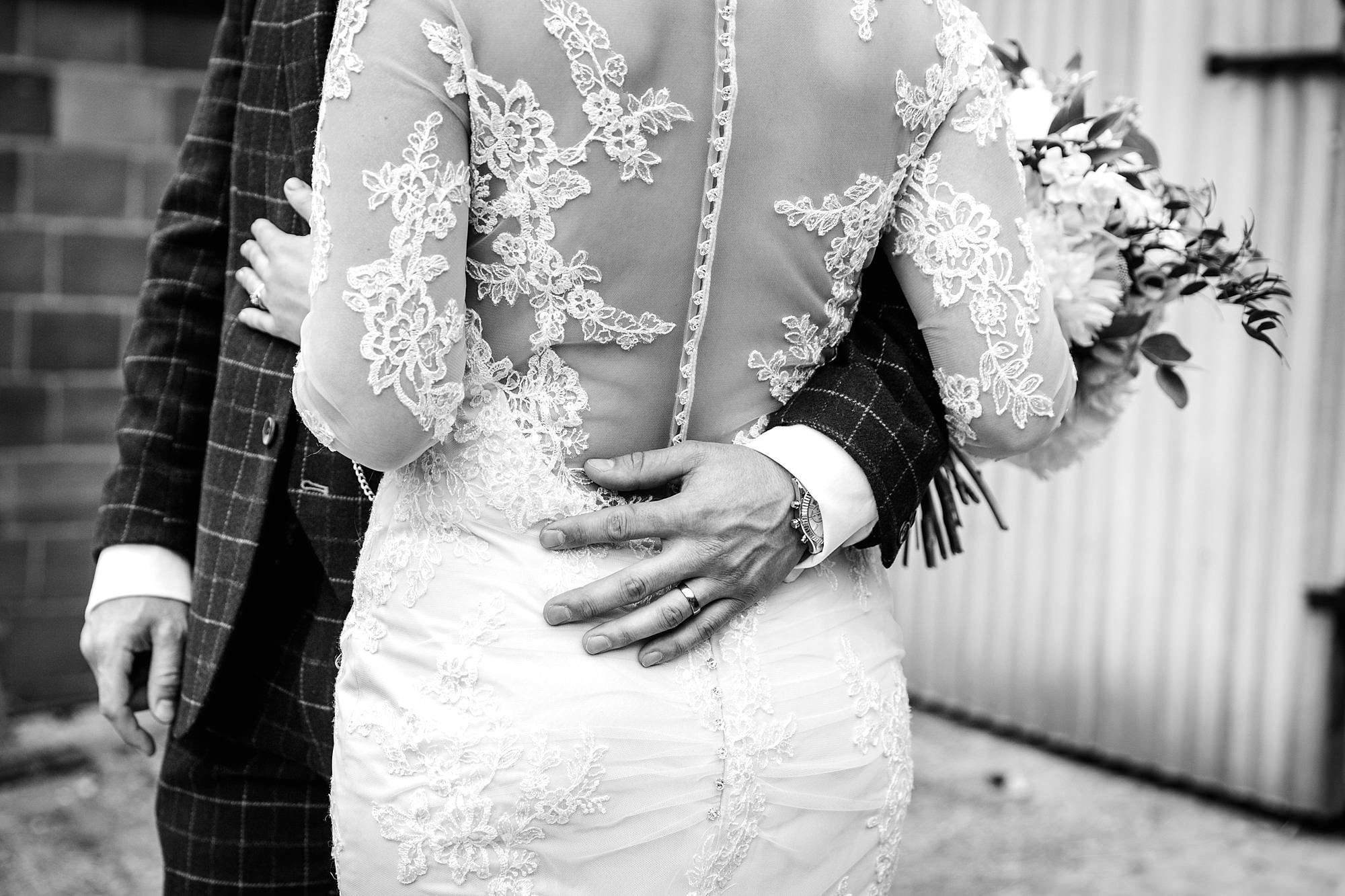 humanist wedding old greens barn groom's arm around bride's waist
