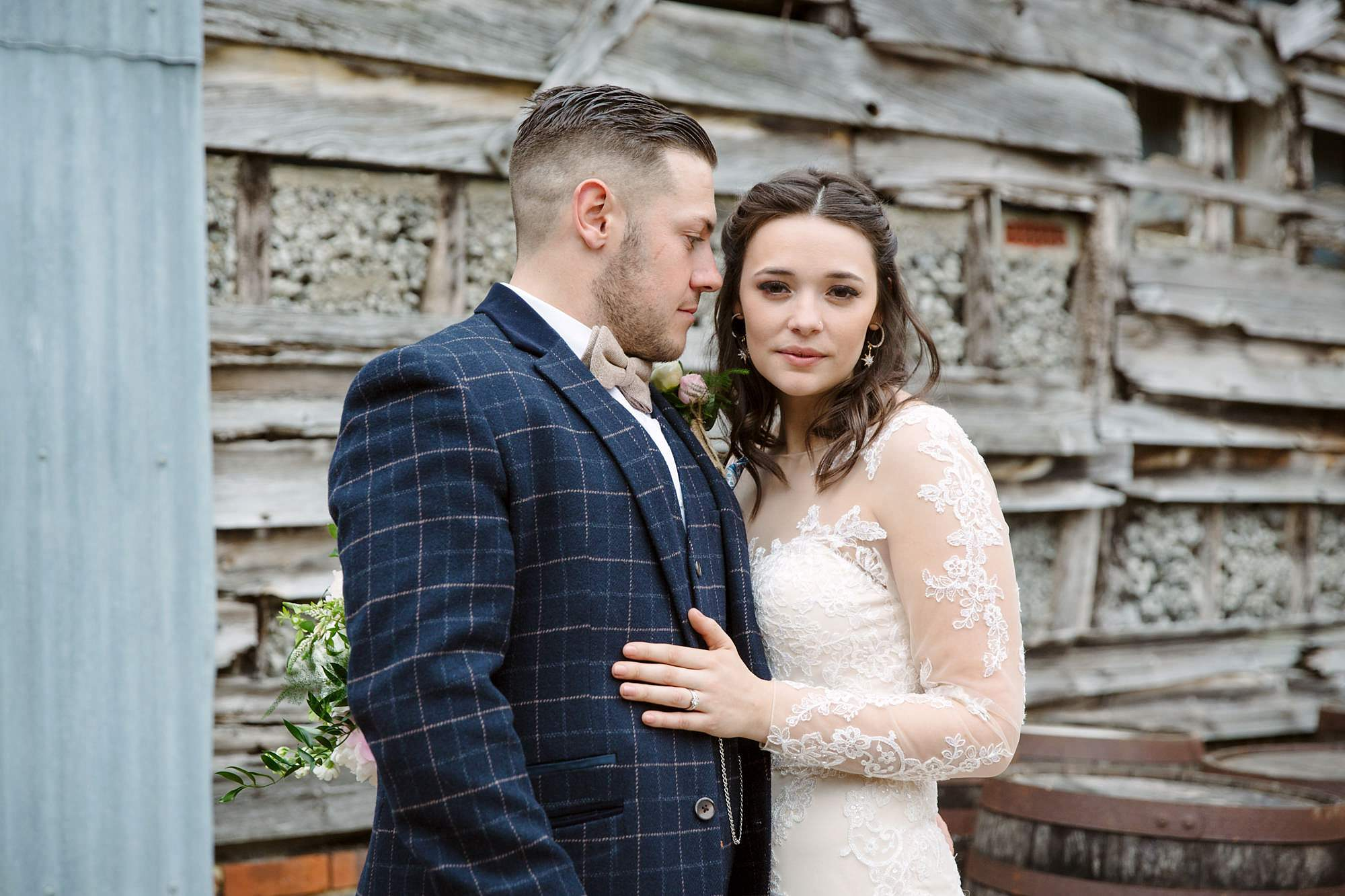 humanist wedding old greens barn bride and groom by rustic old barn