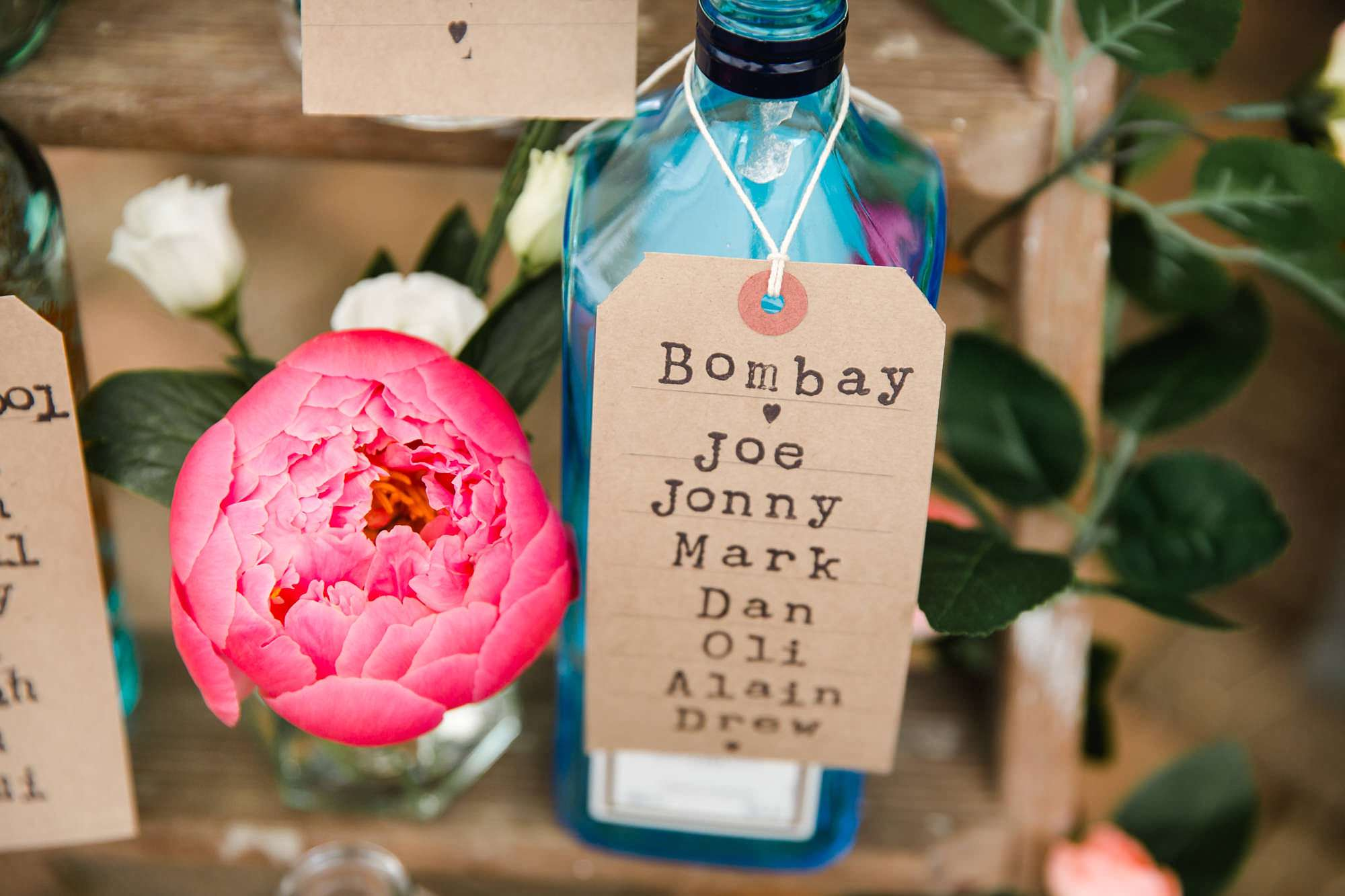 humanist wedding old greens barn gin bottle table plan