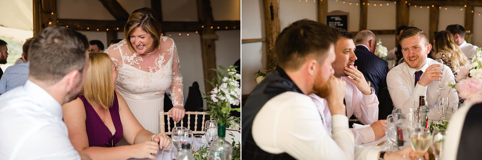 guests chat to each other over dinner at old greens barn wedding