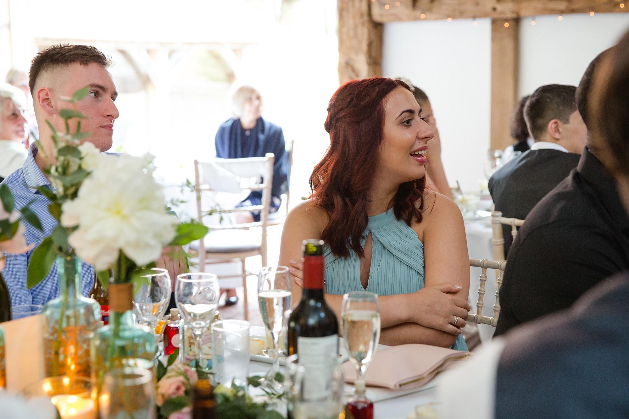 bridesmaid laughing at speeches at old greens barn wedding