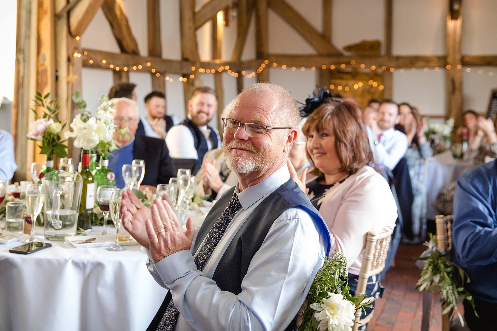 guests clapping after speeches at old greens barn wedding