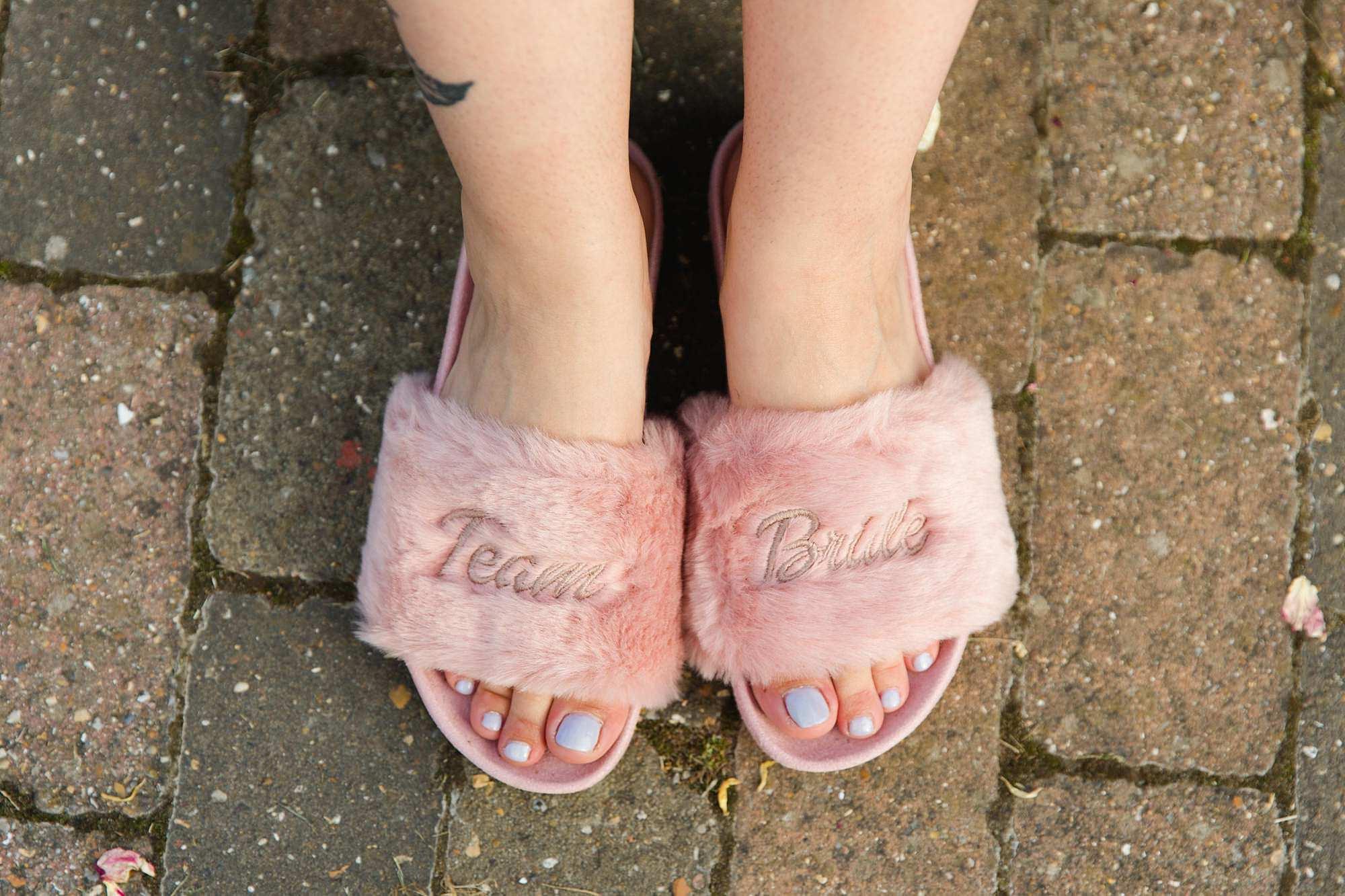 bridesmaid wearing slippers at humanist wedding old greens barn