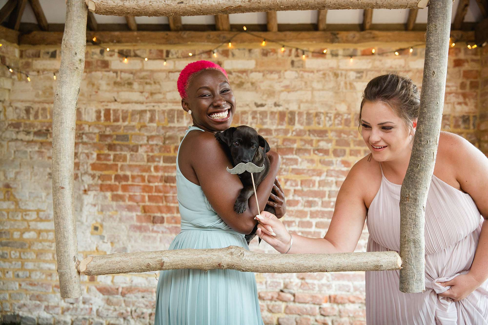 humanist wedding old greens barn guests pose with dog in Photo Booth