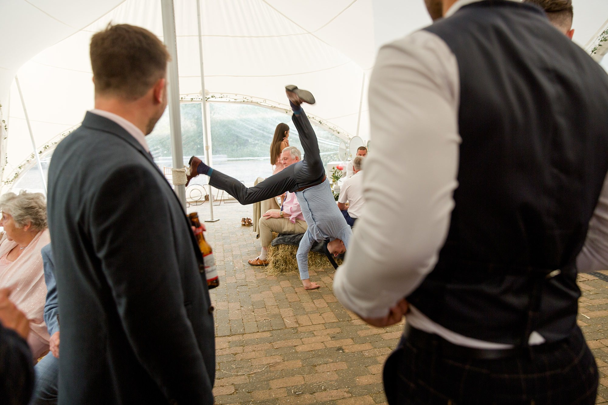 guest doing a cartwheel at humanist wedding old greens barn