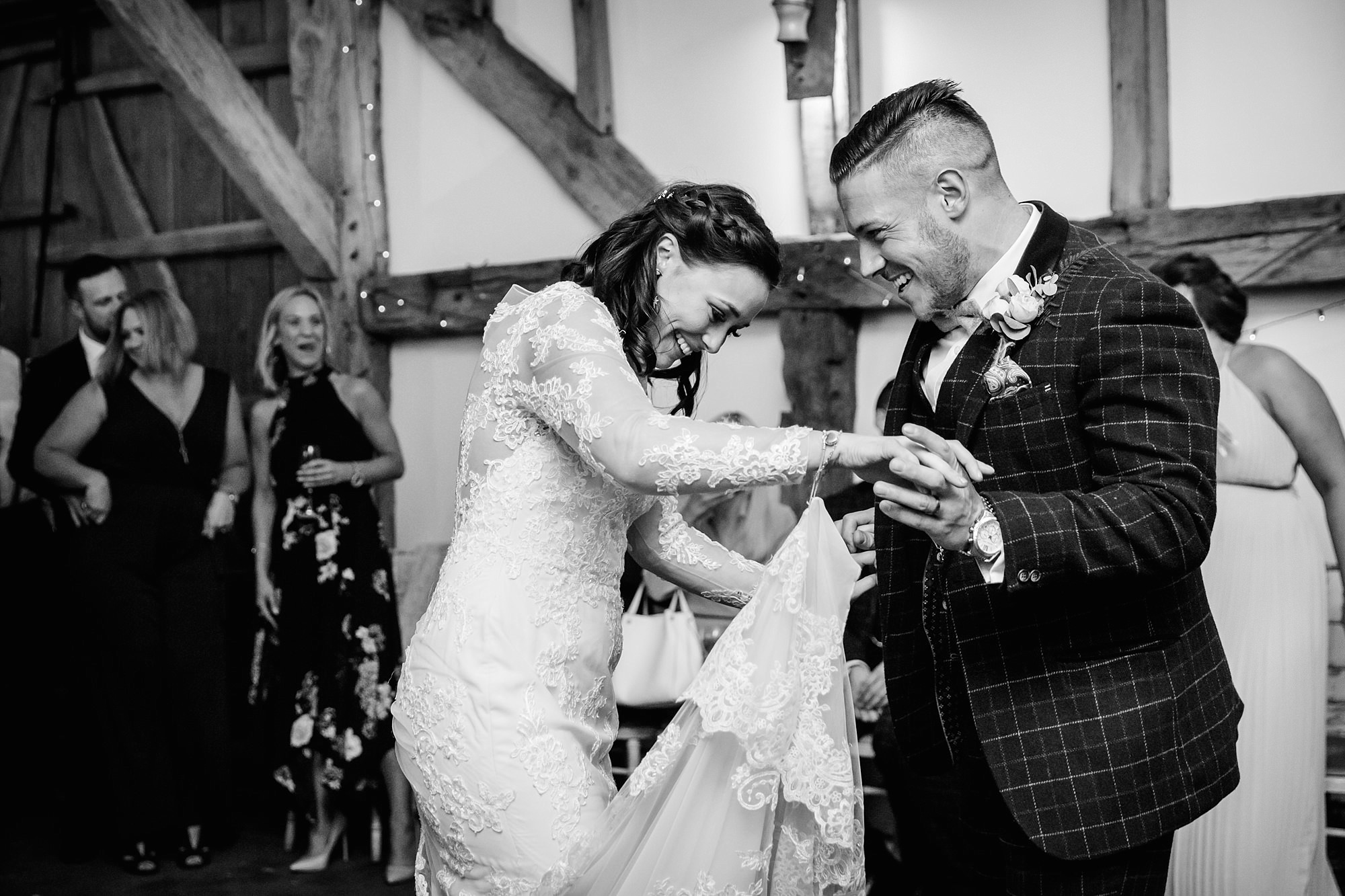 humanist wedding old greens barn bide and groom laugh and dance together