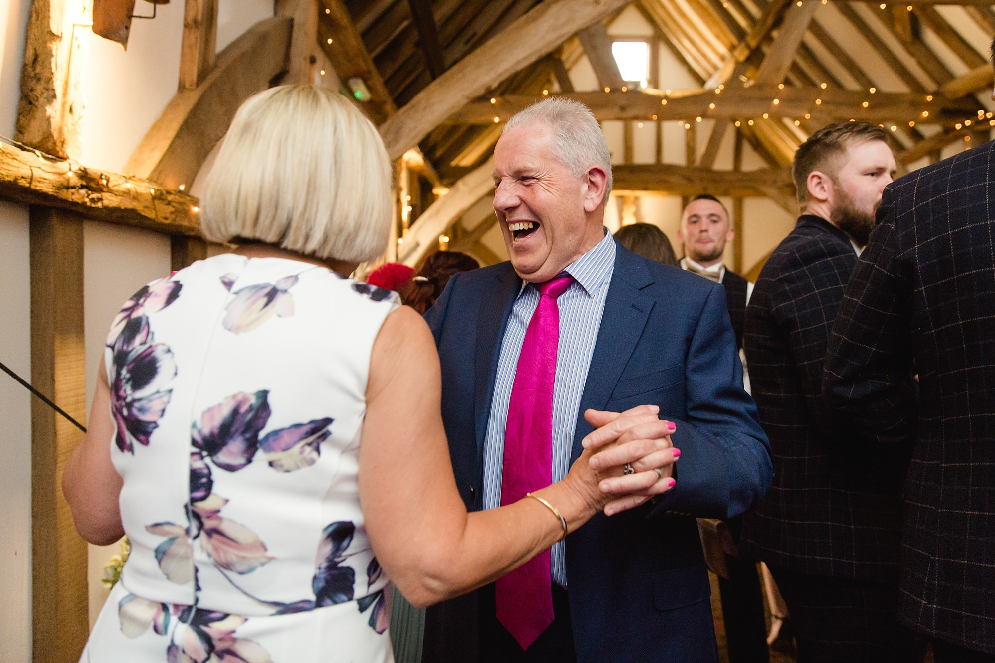 guests laugh and dance together at humanist wedding old greens barn