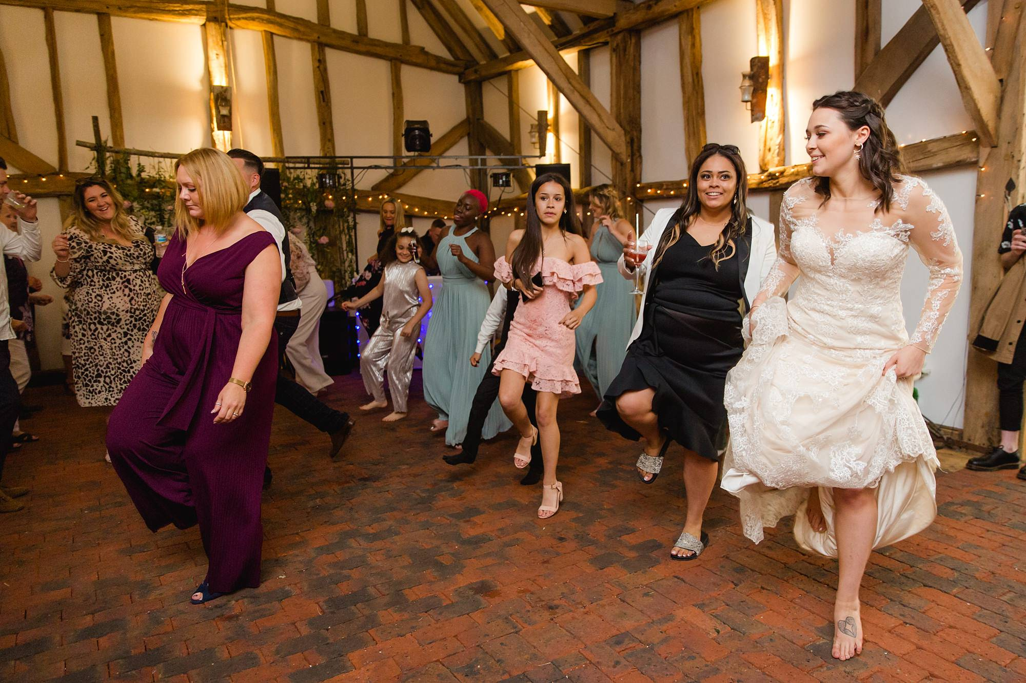 humanist wedding old greens barn bride and guests dance together