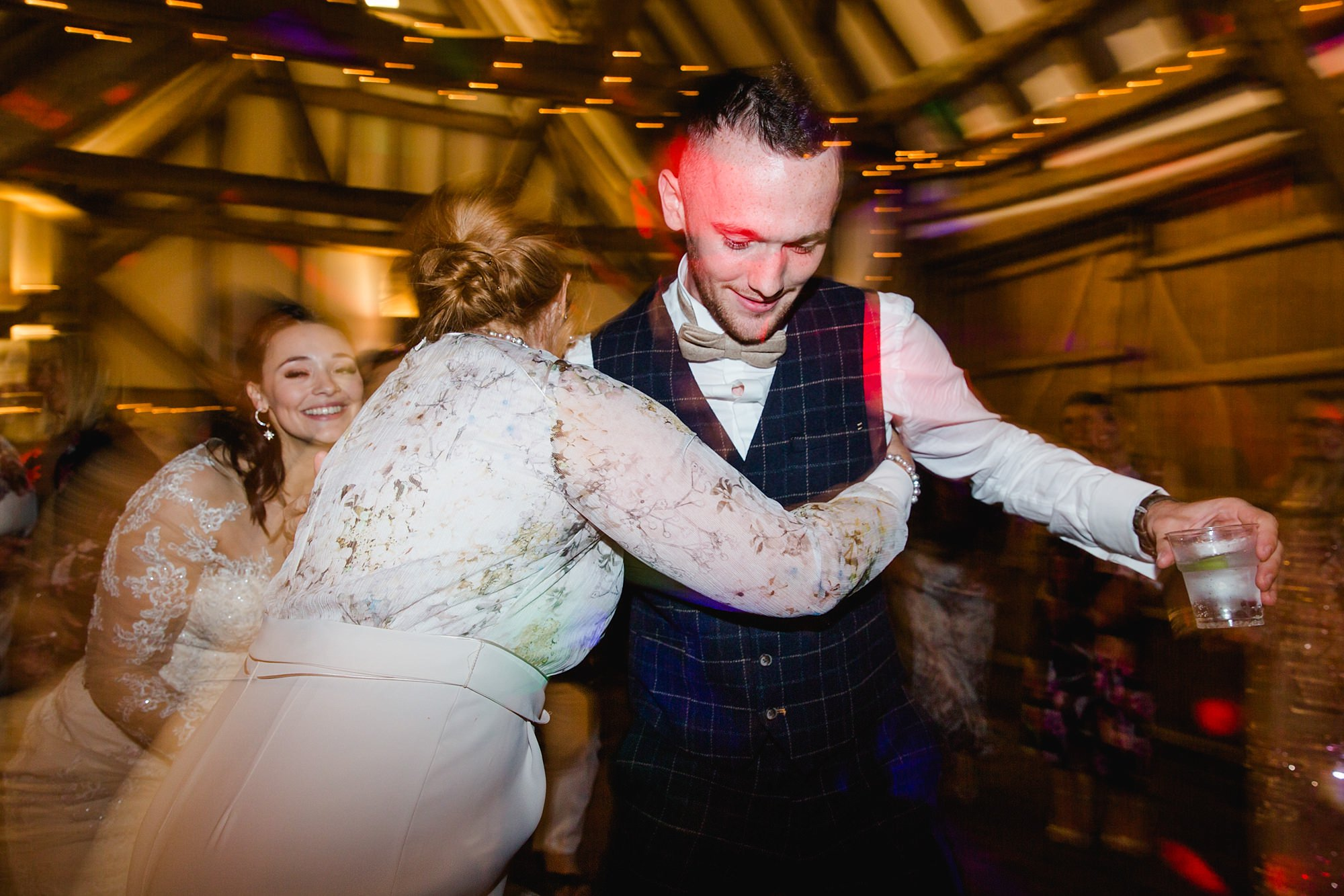 guests dancing together at humanist wedding old greens barn