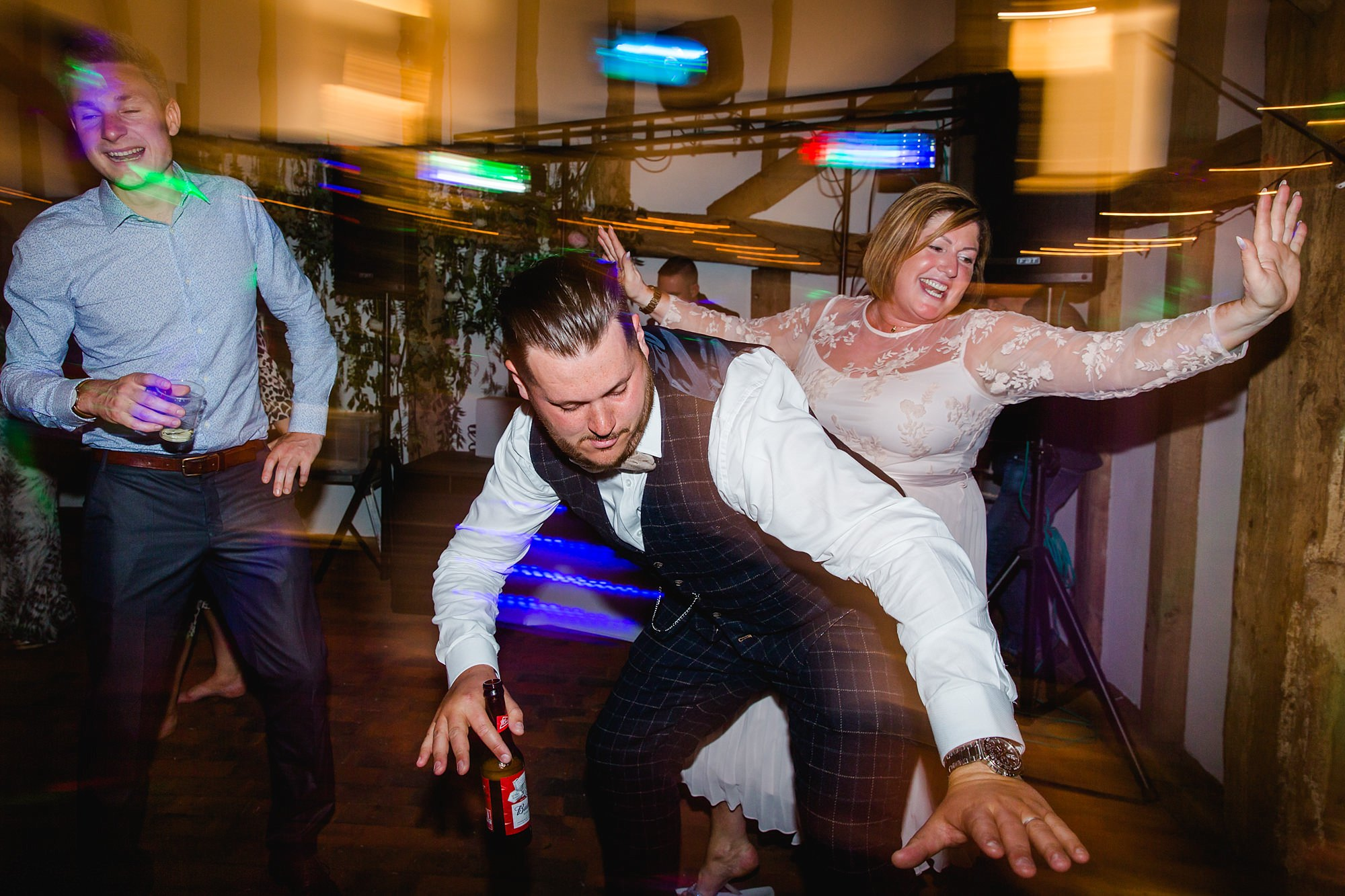 guests having fun on dance floor at old greens barn wedding