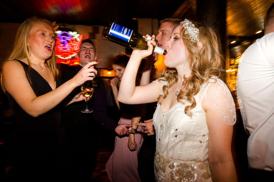fun wedding groom throws confetti on bride