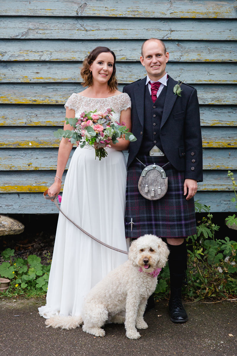 bride and groom with their pet dog