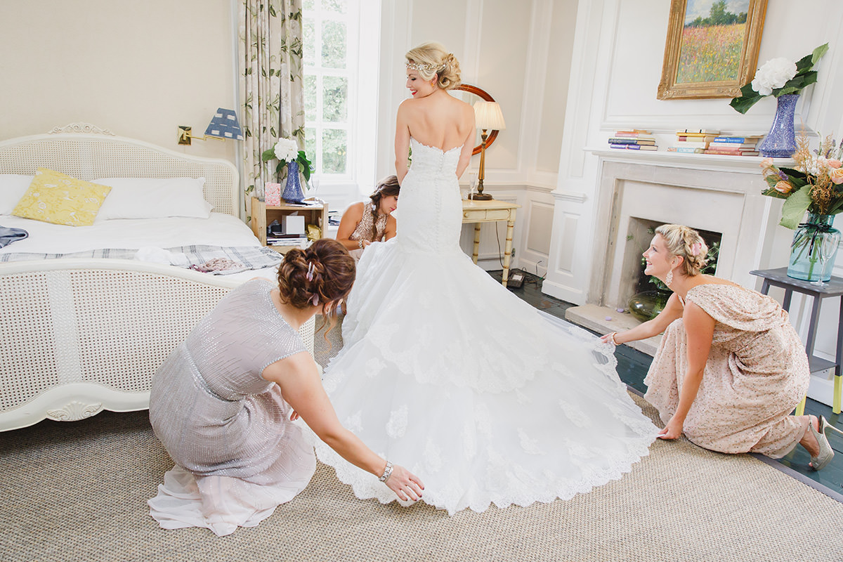 bridesmaids fluff wedding dress hem for bride
