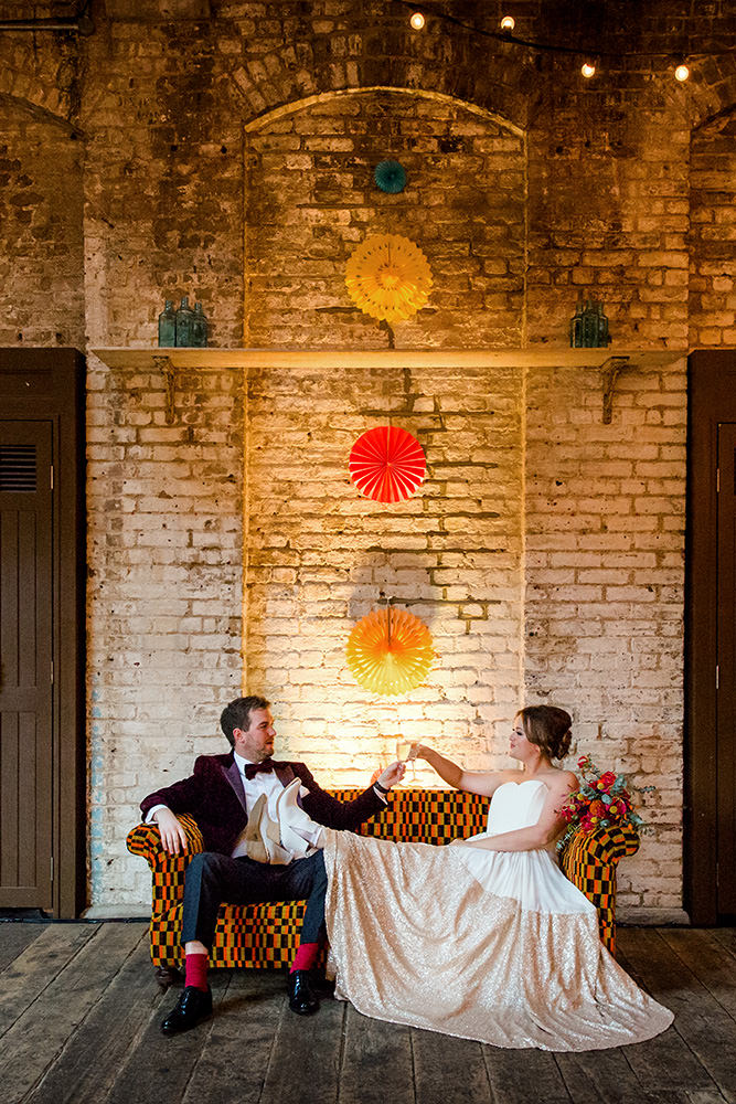 bride and groom raise a toast together at brixton east wedding