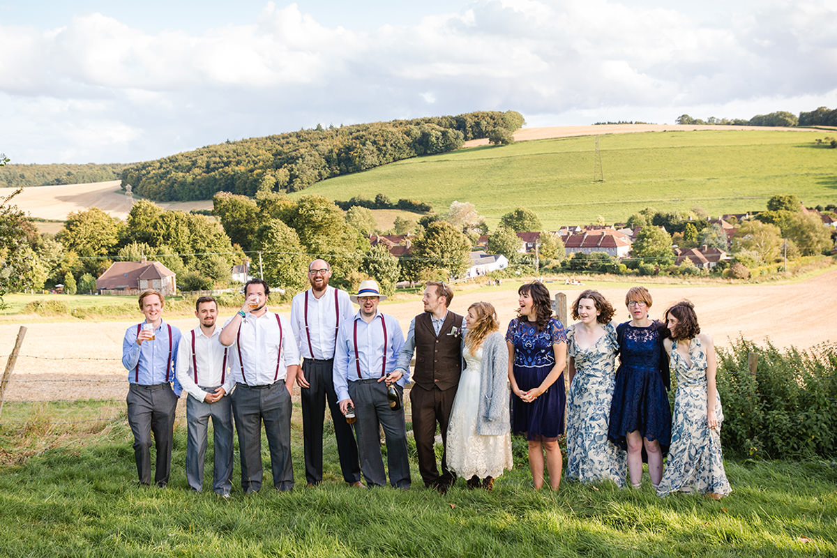 bridesmaids and groomsmen together in field