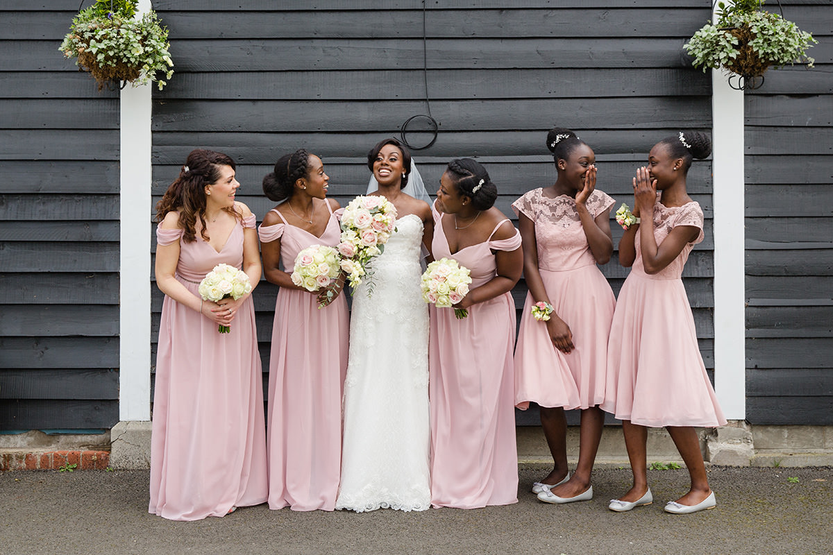 bride and bridesmaids giggling together